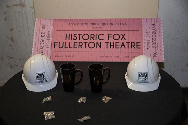 Historic Fox Theatre large sample ticket, hard hats, coffee mugs on a table