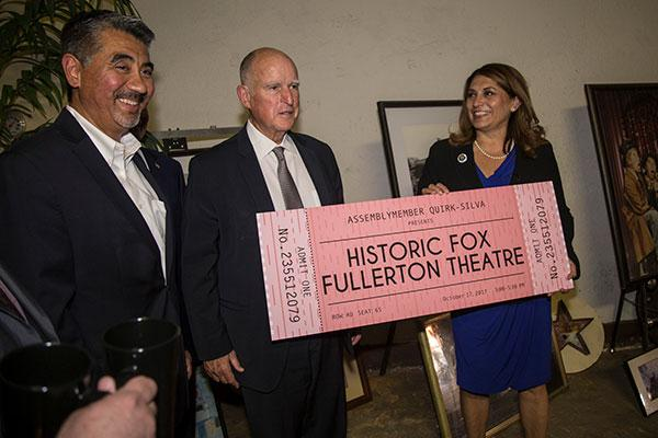 Assemblywomam Sharon Quirk-Silva and Governor Brown holding a large sample ticket to the Fox Theatre